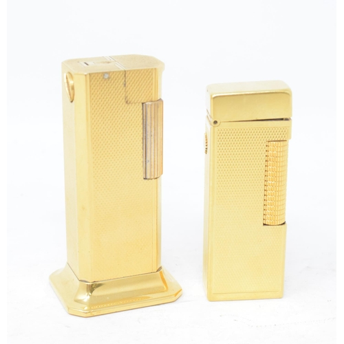 815 - A Dunhill Tallboy cigarette lighter, and another Dunhill cigarette lighter (2)...