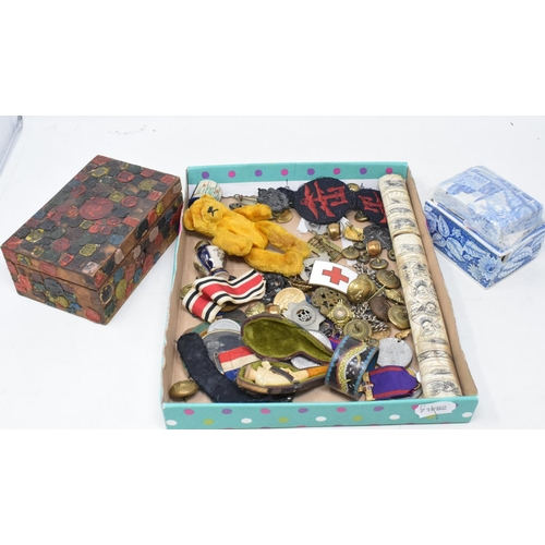 819 - Assorted medallions, a Japanese knife, with a bone handle, a box, applied seals, a teddy bear, and o...