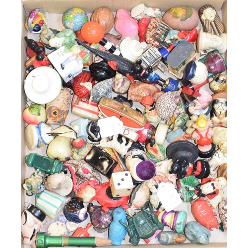 828 - A collection of assorted novelty tape measures, mostly plastic, in various forms including buildings...