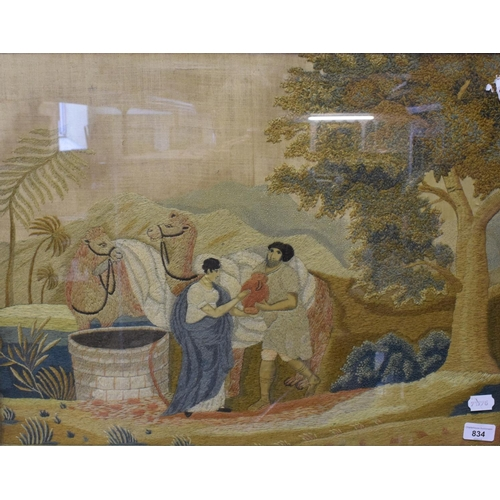 834 - A 19th century silk and woolwork picture, figures drawing water from a well, with camels in the back...