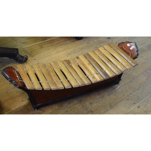 838 - A Tibetan style xylophone, 120 cm wide...