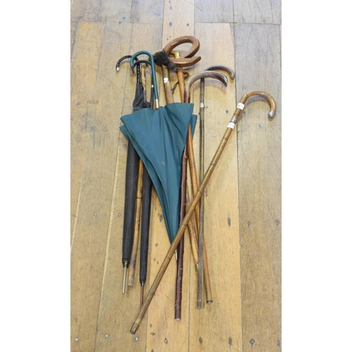 839 - A Liberty parasol, other parasols and assorted walking sticks (qty)...