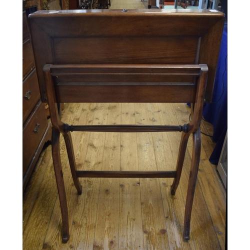 841 - An Edwardian walnut travelling/folding writing table, 62 cm wide...