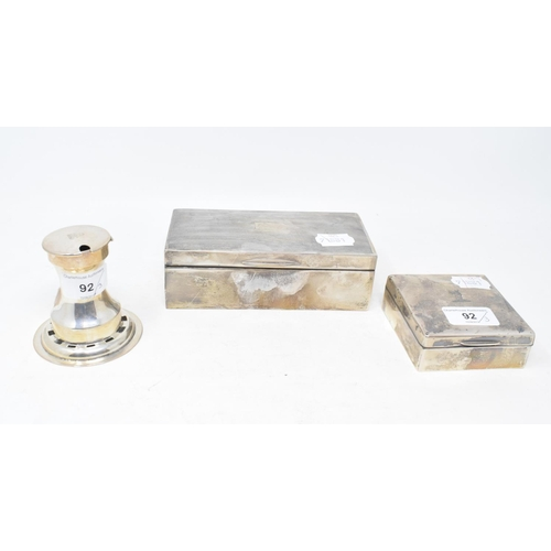 92 - A silver capstan inkwell, crested, and two silver table cigarette boxes (3)...