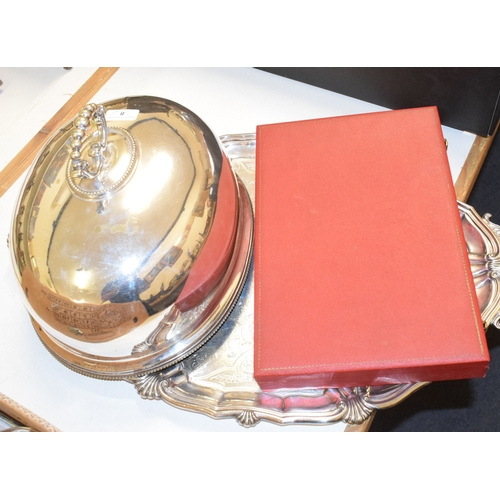 8 - A plated on copper oval chafing dish, with a turned wood handle, a plated on copper biscuit box, a c...