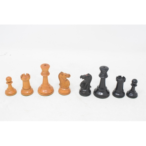 795 - A carved wood chess set, in an inlaid box, 18 cm wide...
