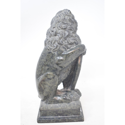 791 - A Grand Tour style carved marble figure, in the form of a lion holding a shield, on a square base, 2...