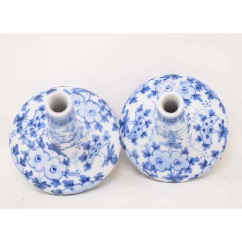 589 - A pair of oriental porcelain vases, with underglaze blue decoration, 8.5 cm high (2)...
