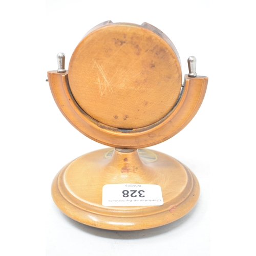 328 - An open face pocket watch, in a Mauchline Ware stand, Falmouth Hotel (2)...
