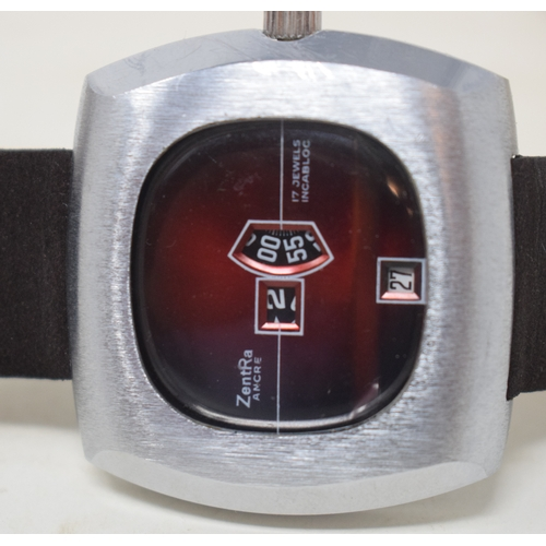 299 - A gentleman's stainless steel Zentra jump hour wristwatch, with a red dial...
