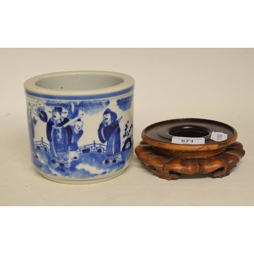 571 - A Chinese blue and white porcelain cylindrical pot, decorated figures, 11.5 cm high, on a carved har...