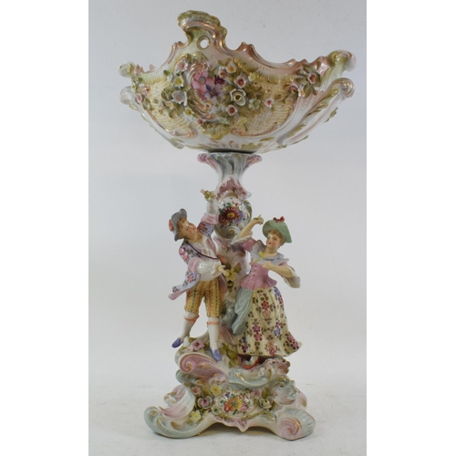 553 - A late 19th century Sitzendorf porcelain comport, the base applied a courting couple, and encrusted ...