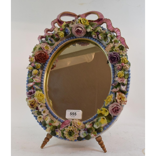 555 - A 19th century Meissen style porcelain strut mirror, with a ribbon tie and encrusted flowers and fol...