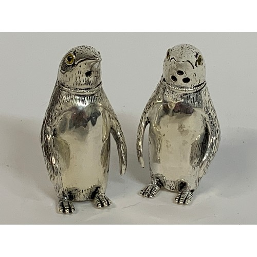 454 - A pair of penguin salt and pepper pots