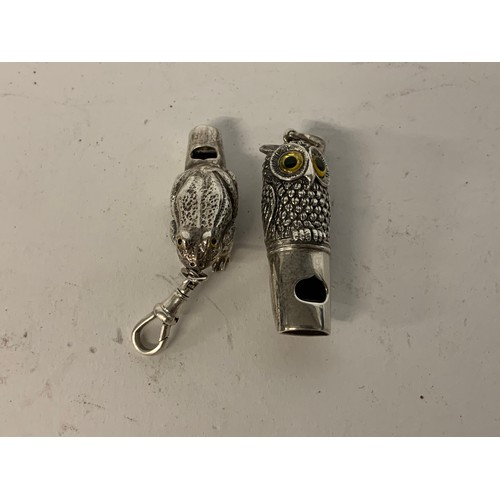 459 - A silver owl whistle, and a similar frog whistle