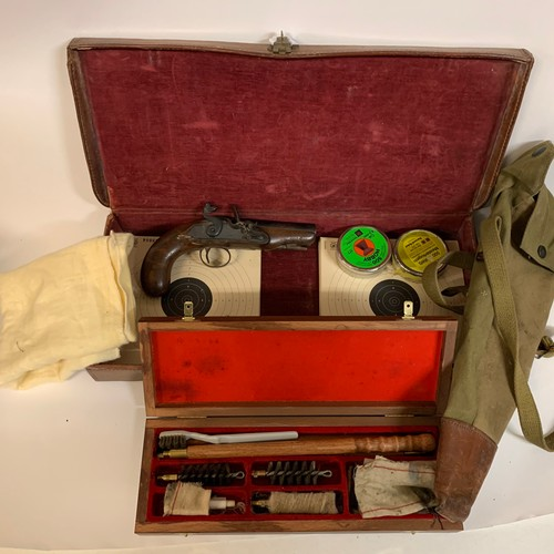 436 - An early 19th century flintlock pistol, Archer, 20 cm, a leather case, and a set of cleaning brushes...