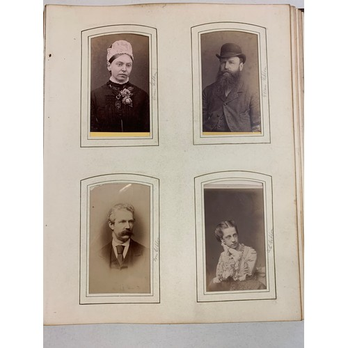 407 - A Victorian photograph and scrap album, Souvenir 1871, in a leather binding with a metal clasp and k...