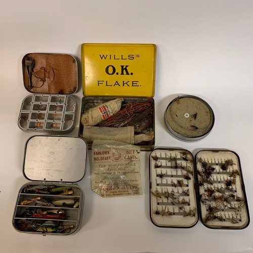 433 - Assorted fishing lures, a leather reel box, a Hardy's cardboard box, various fly tins, and other acc...