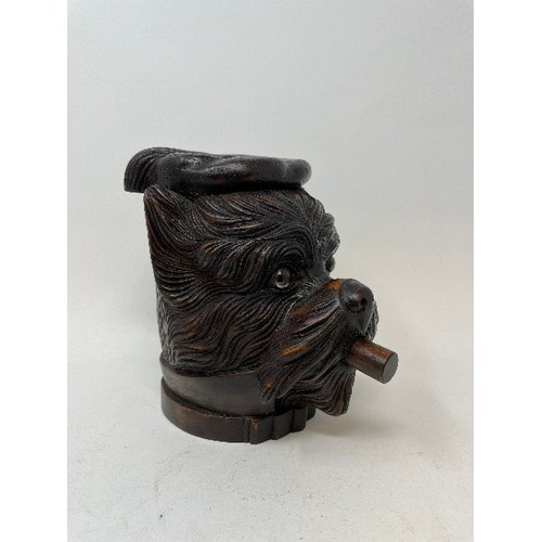 448 - A carved wood tobacco box and cover, in the form of a dog, 18 cm high