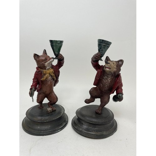 446 - A pair of painted bronze candlesticks, in the form of a fox and a bear, 18 cm (2)