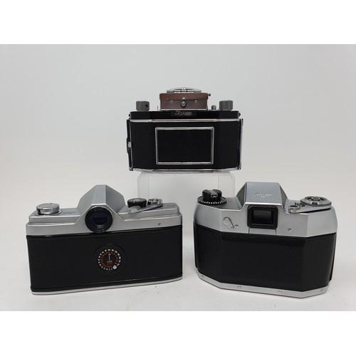 16B - An Exa Thagee camera, lacking lens, an Exa 500 camera, and a Minolta SR - 1 (3)  Provenance: Part of...