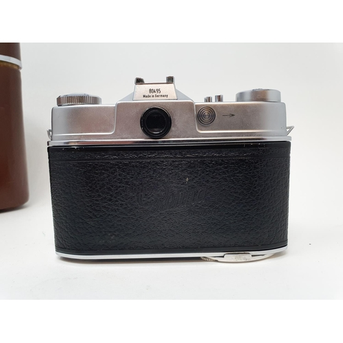 10 - A Kodak Retina Reflex S, serial number 80495, with two extra lenses, in leather carrying case  Prove...