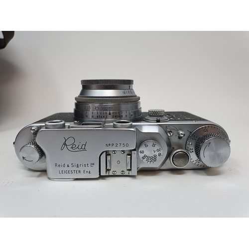 16 - A Reid & Sigrist ltd camera, serial number P2750, with leather outer case, lens, and accessories in ...