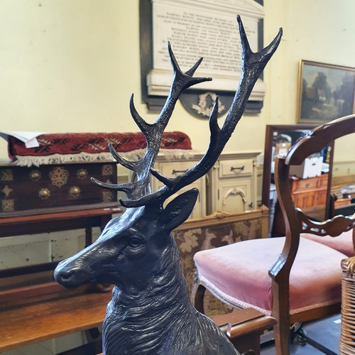 450 - A large pair of bronze stags, on rocky mounts, with marble bases, the largest 74 cm high