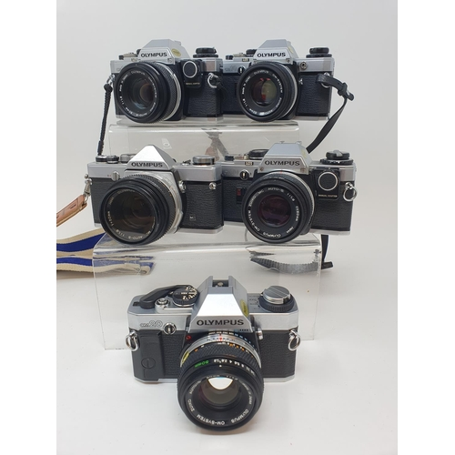 17 - An Olympus OM-10 camera, two other OM-10s an Olympus OM-20 and an Olympus OM-1 (5)  Provenance: Part...