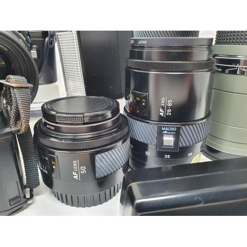 18 - A Minolta 9000 camera, a Minolta 7000 camera, various lenses and accessories in a carrying case  Pro...