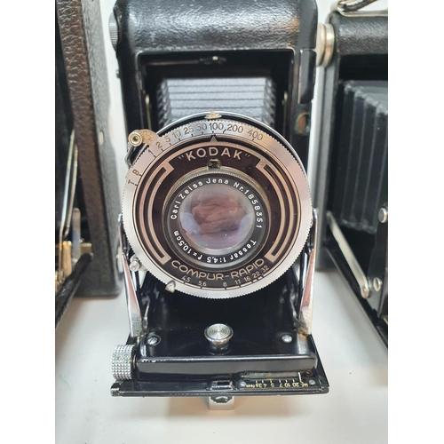 19 - A Kodak Regent folding camera, with leather outer case, a Kodak folding camera, with leather outer c...