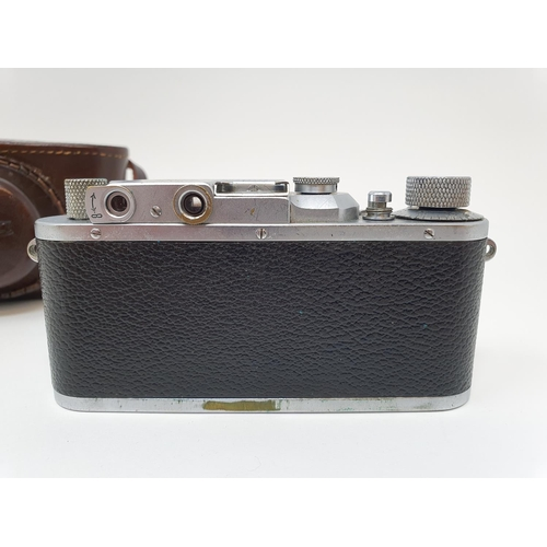 2 - A Leica IIIa camera, serial number 324178, with leather outer case  Provenance:  Part of a vast sing...