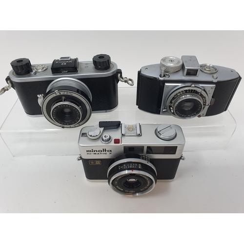 22 - A Kodak 35 camera, a Minolta Hi - Matic F camera, and an Agfa Karat camera (3)  Provenance: Part of ...