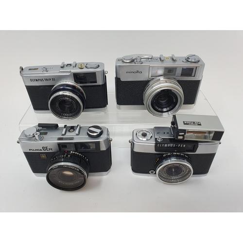 23 - An Olympus Trip 35 camera, an Olympus - PEN camera a Fujica GER camera and a Minolta AL - F camera (...