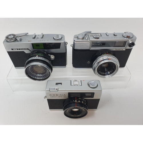 26 - A Cosina compact 35S camera, a Yashica camera, serial number T-737513, and a Pretri 7 camera (3)  Pr...