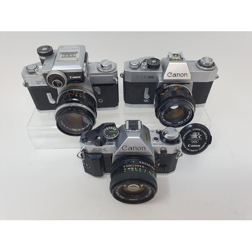 28 - A Canon FP camera, a Canon EX Auto, and a Canon AE-1 camera (3)  Provenance: Part of a vast single o...