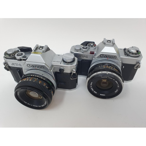 29 - A Canon AT-1 camera and a Canon AV-1 camera (2) Provenance: Part of a vast single owner collection o...