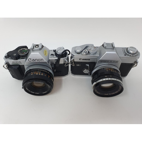30 - A Canon Pellix camera and a Canon AE-1 camera (2)  Provenance: Part of a vast single owner collectio...
