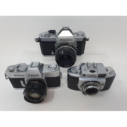 31 - A Nikkormat Nikon, a Minolta A camera and a Canon EX EE camera (3)  Provenance: Part of a vast singl...