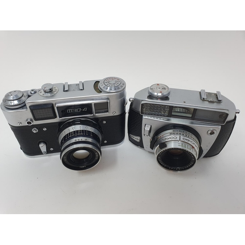 42 - A Badda Matic II camera and a Russian camera (2)  Provenance: Part of a vast single owner collection...