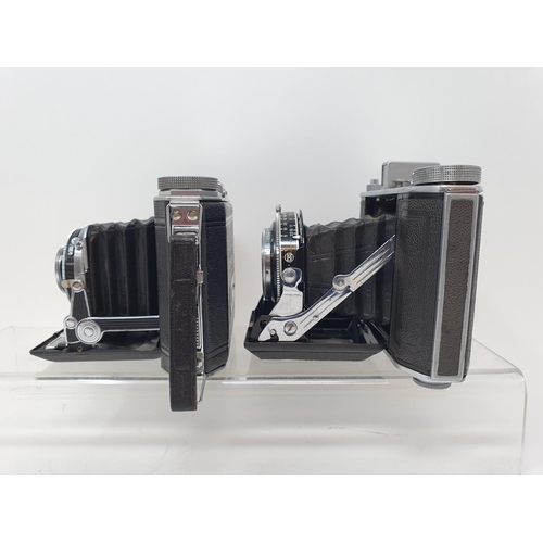 46 - An Olympus-Six folding camera, serial number 21128 and a Duo 620 folding camera (2)  Provenance: Par...