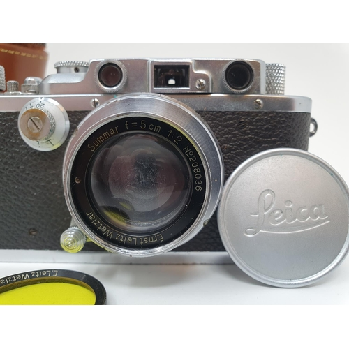 5 - A Leica camera, serial number 120761, with leather outer case  Provenance: Part of a vast single own...