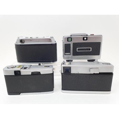 50 - A Minolta 24 Rapid camera, an Arette C camera, a Ricoh Auto 126 camera, and an Olympus Trip 35 camer...