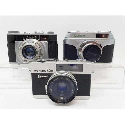 51 - A Konica C35 camera, a Futura camera and a Arette IA camera (3)  Provenance: Part of a vast single o...