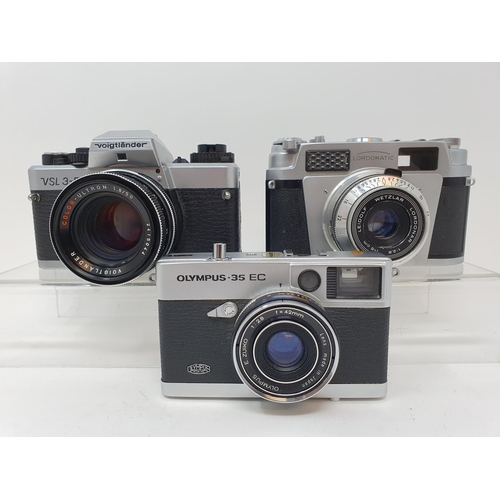 53 - An Olympus-35 EC camera, a Leidolf Lordomatic camera and a Voigtlander VSL 3-E camera (3)  Provenanc...