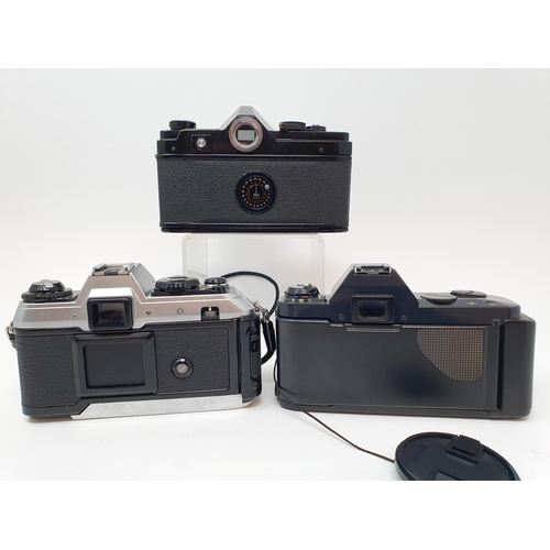56 - A Minolta SR-7 camera, a Canon T50 camera and a Konica FT-1 camera (3)  Provenance: Part of a vast s...