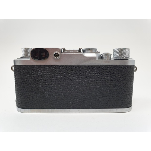 6 - A Leica IIIf camera, serial number 798046, with leather outer case  Provenance: Part of a vast singl...