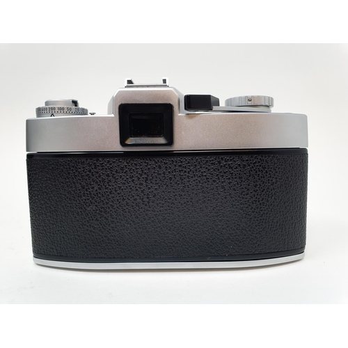 8 - A Leica Leicaflex camera, serial number 1115659, with leather outer case  Provenance: Part of a vast...