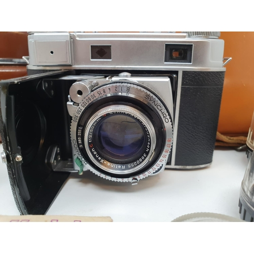 9 - A Kodak Retina III, serial number 231293, in leather outer case, various accessories and lens, in le...