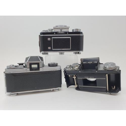 12 - An Exakta VX 1000 camera body, and two Exakta camera bodies (3)  Provenance: Part of a vast single o...